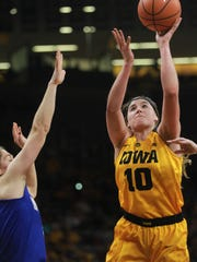 Iowa's Megan Gustafson takes a shot during the Hawkeyes' game against Drake at Carver-Hawkeye Arena on Thursday, Dec. 21, 2017.