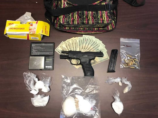 Police seized a quantity of drugs and a firearm when they arrested Wright Thursday.