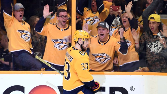 Nashville Predators fans celebrate after a goal by left wing Viktor Arvidsson during the second period Sunday night.