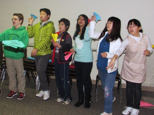 Students from Nakagawa, Japan and their counterparts from Horseheads test fly paper airplanes Thursday at the National Soaring Museum on Harris Hill in Big Flats.