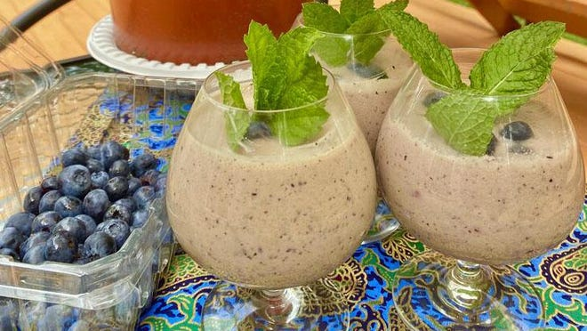 Tumeric and Blueberry Lassi is a drink that doesn't just taste good, it has anti-inflammatory properties from the tumeric and anti-oxidants from the blueberries.