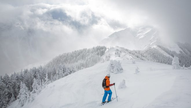 This undated photo provided by Taos Ski Valley shows a skier ascending Kachina Peak at the ski resort located in Taos. The summit of Kachina Peak is 12,481 feet. Last year, the resort opened its long-awaited lift to the peak, which takes skiers to expert terrain that could previously only be accessed by those able to hike up.