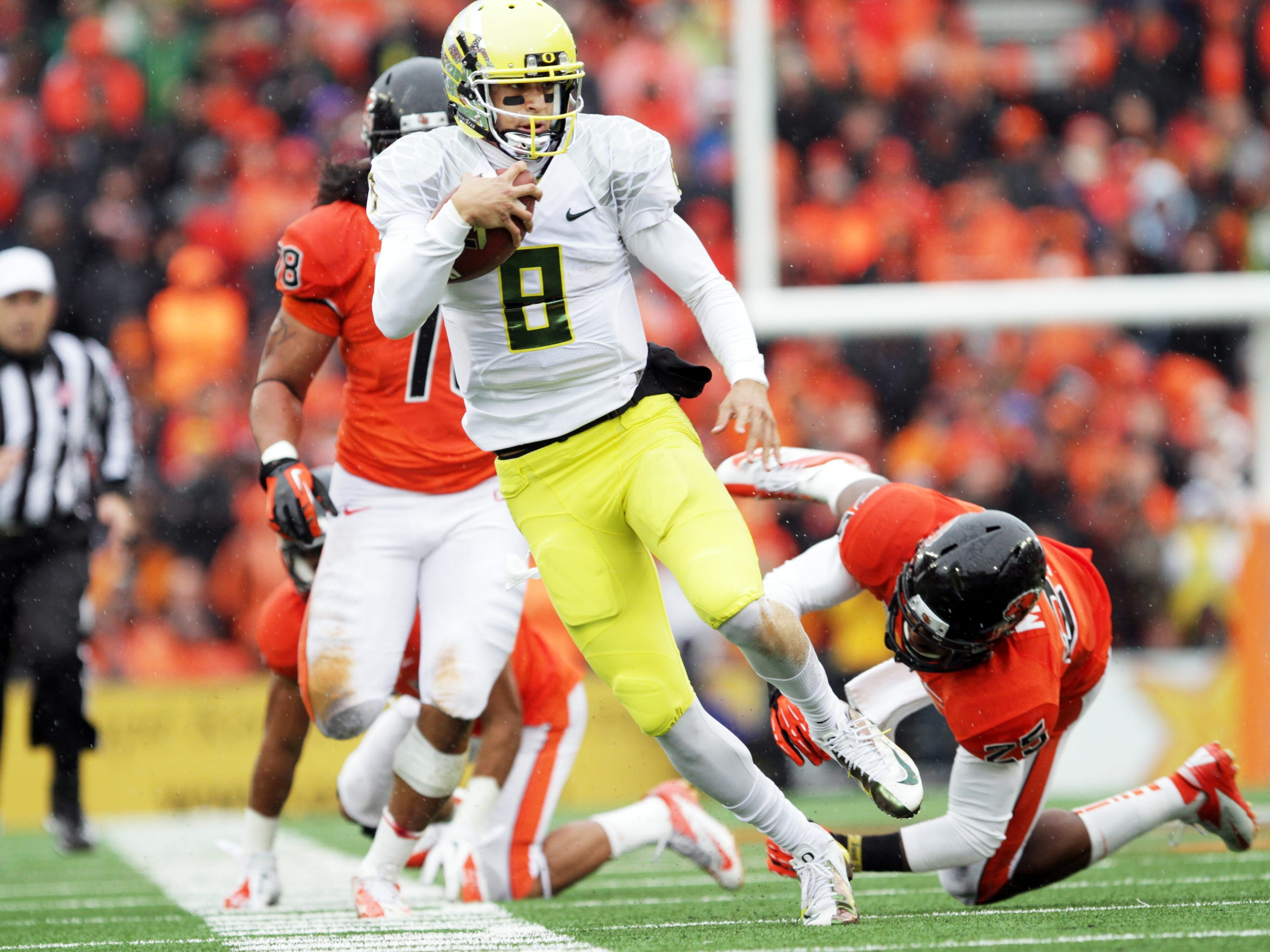 Marcus Mariota eludes trouble as the Ducks win the Civil War college football game between Oregon and Oregon State at Reser Stadium in 2012.