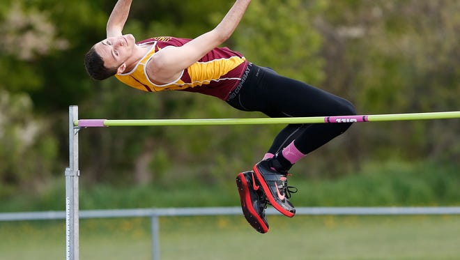 Omro's Jacob Lautenschlager clears 5-feet, 8-inches during the high jump competition at the Flyway Conference Meet on Monday in Rosendale.