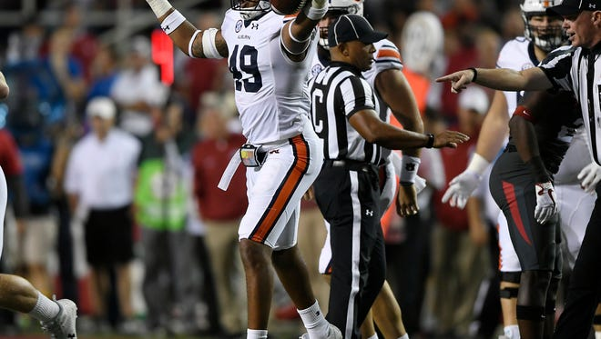Auburn linebacker Darrell Williams (49) recovers and Arkansas fumble during a punt in the first half.