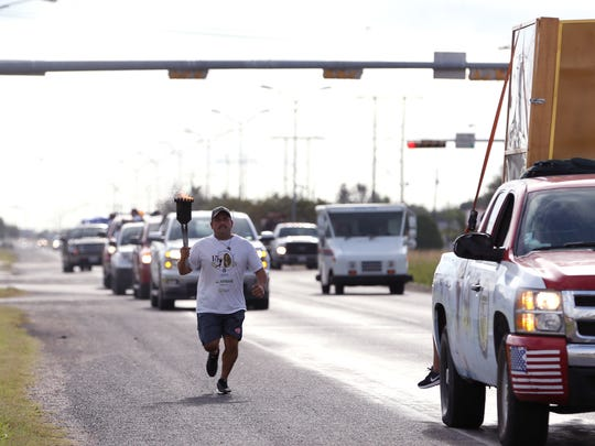 Fernando Fernandez runs with a the torch during the 15th annual Carrera Antorcha Guadalupana torch run on Tuesday, Nov. 1, 2016 along Leopard Street. The run begins in Mexico City, Mexico and continues to New York City, New York. It brings attention to the need for immigration reform, said organizers.