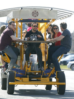 Philip Szal of Rochester, owner of Rochester Pedal Tours takes a birthday party for a ride on Hickory Street during a sunny day in downtown Rochester. It can hold thirteen people, it has a sound system and the ride goes for $350 for two hours on weekends.