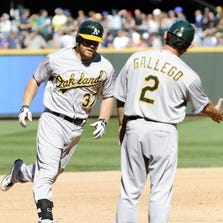 Oakland Athletics first baseman Brandon Moss (37) rounds third base after hitting a solo home run against the Seattle Mariners during the sixth inning at Safeco Field.
