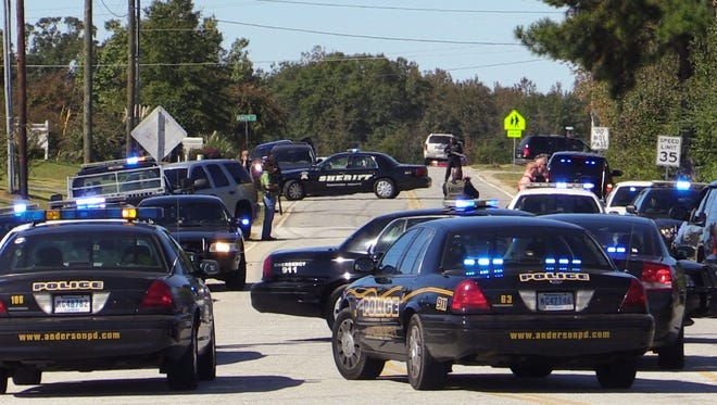 New Prospect Church Rd. was closed as Law enforcement from the upstate converged to search for the gunman, who hi jacked a car in Townville, abandoned it, just off highway 24 and shot a K 9 officer from the Anderson County Sheriff's office that was sent into the woods after the suspects.