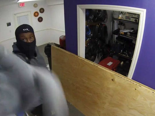 A still frame from a surveillance video shows a scene from a burglary at The Naples Studio, a Naples video production company, on Sept. 19, 2017.