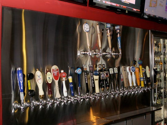 Beer taps in the bar area at the Tap House Grill, 8740 Montgomery Road, Sycamore Twp.