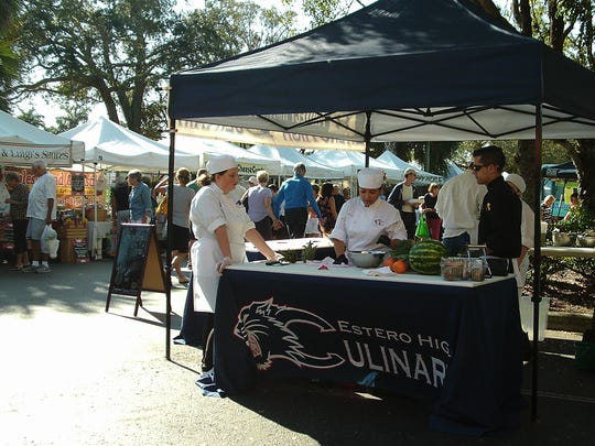 Estero High School culinary instructor Jeremy Jasper and his students offer to chop produce for a small donation every Saturday at The Promenade Farmer's Market in Bonita Springs.