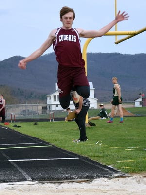 Stuarts Draft's Colby Phillips soars above the the pit during the boys triple jump competition in a Shenandoah District meet at East Rockingham High School in Elkton, Va., on Wednesday, April 5, 2017.