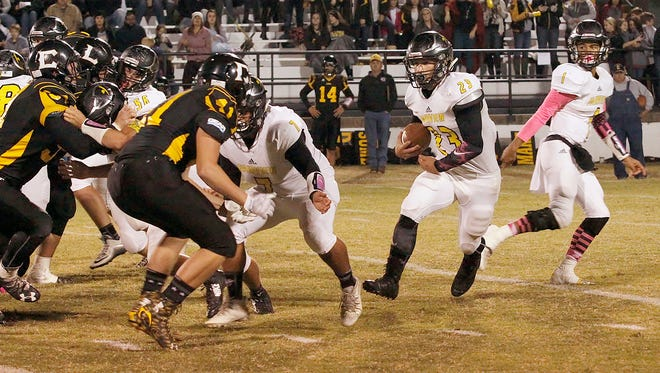 Fairview's #1 Kam Harris-Lusk hands the ball off to #23 runningback Hunter Caldwell, who runs for a 60-yard touchdown in the October 21 win over Camden. Observer
