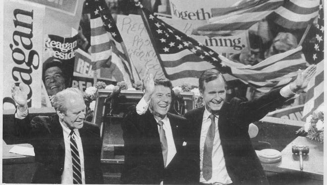 7/17/80--DETROIT:  Former President Gerald Ford shares the spotlight with Republican presidential and vice presidential candidates Ronald Reagan and George Bush after their acceptance speeches to the Republican National Convention on July 17, 1980, at Joe Louis Arena.