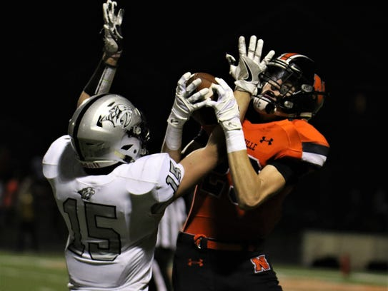 Making a nifty 36-yard TD catch for Northville is Ben