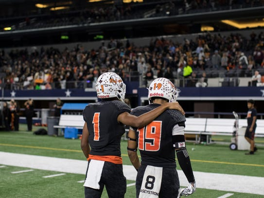 Refugio's Donavon Bailey and Jamel LaFond comfort each