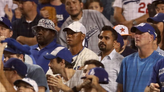 Professional golfer Tiger Woods attends Game 2 of the 2017 World Series between the Houston Astros and the Los Angeles Dodgers at Dodger Stadium.