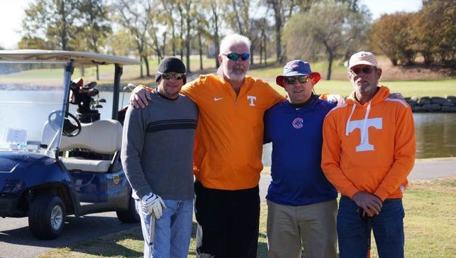 The annual Santa Classic golf tournament raised nearly $7,000 for the annual Shop with a Cop program run by Gallatin Police and Fire departments.