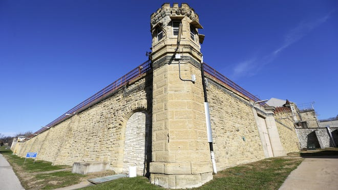 This 2013 file photo shows a guard tower at the Iowa State Penitentiary in Fort Madison, Iowa. Lawmakers are demanding to know how convicted armed robber Justin Kestner was able to escape from the maximum-security prison on Sunday.