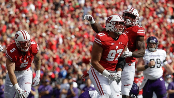 FILE - In this Saturday, Sept. 30, 2017, file photo, Wisconsin's Isaiahh Loudermilk (97) and Leon Jacobs celebrate after a sack of Northwestern quarterback Clayton Thorson (18) during the first half of an NCAA college football game in Madison, Wis. Ninth-ranked Wisconsin is turning up the pressure. After swarming Northwestern for eight sacks, the Badgers have their sights set on Nebraska this weekend. (AP Photo/Morry Gash, File)