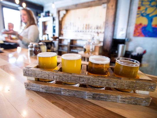 A flight of beer samples at the Hired Hand Brewing