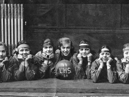 The Lancaster High School girls' basketball team, 1919-1920, from left: Helen Moody, Mildred Anderson, unidentified, unidentified, captain Mary Kerns, Kate Nolder, Gace Herman, Esther Shaw, and Katherine Brenner.