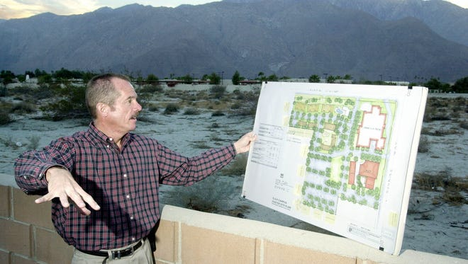 In 2002, Jack Newby, then-director of public policy for Desert AIDS Project, looks over artist renderings of the original Vista Chino Campus, which is proposed to include apartments, a county health care facility and a homeless day care center on the corner of Vista Chino and Sunrise Avenue in Palm Springs.