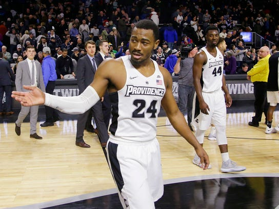 Providence guard Kyron Cartwright (24) acknowledges the crowd as he walks off the court after an NCAA college basketball game against Xavier, Saturday, Jan. 6, 2018, in Providence, R.I. Providence upset Xavier 81-72 . (AP Photo/Stephan Savoia)