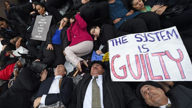 """Protesters in California hold a """"die-in"""" to demonstrate against police brutality."""