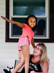 Amy Bailey and her daughter Sydney hang out on the front porch on a Thursday afternoon. 