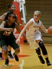 Richmond's Braxtyn Hurley moves the ball against Arsenal Tech's Emoni Smith during a girls basketball game Friday, Dec. 18, 2015, in the Tiernan Center.