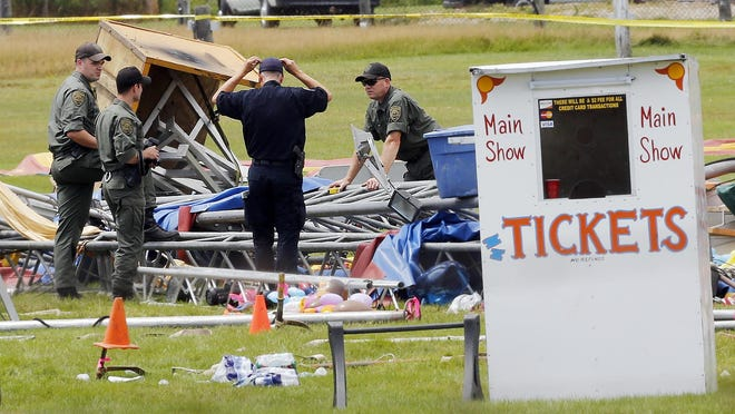 Investigators on the scene of a circus tent collapse in Lancaster, N.H. in August 2015.