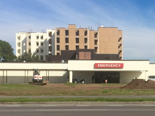 University Hospital and Clinics is getting a fresh coat of paint.