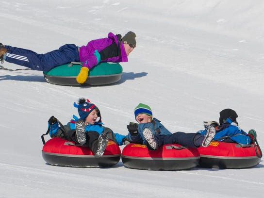 Snow tubing proves a favorite activity among young residents (and big kids, too)