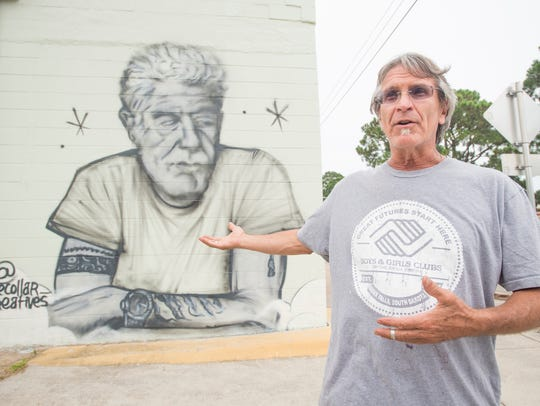 Owner Ric Kindle talks about the Anthony Bourdain mural painted outside his new Live Juice Bar under construction in downtown Pensacola on Monday, June 18, 2018. Kindle and the artists want to bring awareness to suicide prevention.