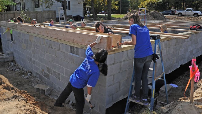 Volunteers work on a Cumberland County Habitat for Humanity home.