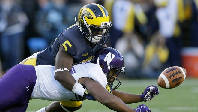 Michigan safety Jabrill Peppers (5) deflects a pass intended for Northwestern wide receiver Christian Jones on Saturday, Oct. 10, 2015, in Ann Arbor.