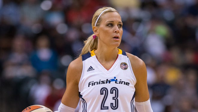 Indiana Fever's Katie Douglas (23) brings the ball up court during the first half of an WNBA basketball game at Bankers Life Fieldhouse in Indianapolis, Sept. 13, 2013.