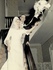 Carol and Tony Grantz stand on the staircase at the Peterson-Dumesnil House in Crescent Hill as she tosses her bouquet at their wedding reception April 30, 1966.