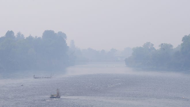 Smoky air from nearby wildfires settled over Redding on Sunday, creating unhealthy conditions.