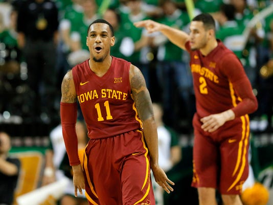 Iowa State's Monte Morris (11) and Abdel Nader (2) celebrate a 3-point basket by Morris against Baylor during the second half of an NCAA college basketball game, Tuesday, Feb. 16, 2016, in Waco, Texas. Baylor won in overtime, 100-91. (AP Photo/Tony Gutierrez)