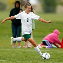 C.M. Russell's Eme McLaughlin takes a shot against Great Falls High in a crosstown game Tuesday at Siebel Soccer Park.