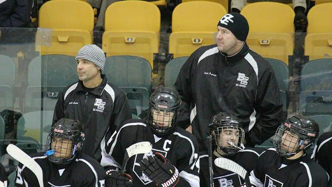 Bishop Eustace ice hockey coaches (back l-r) Mike Green and Keith Primeau work the bench, as senior captain Chayse Primeau, front second from left, joins teammates on the bench.