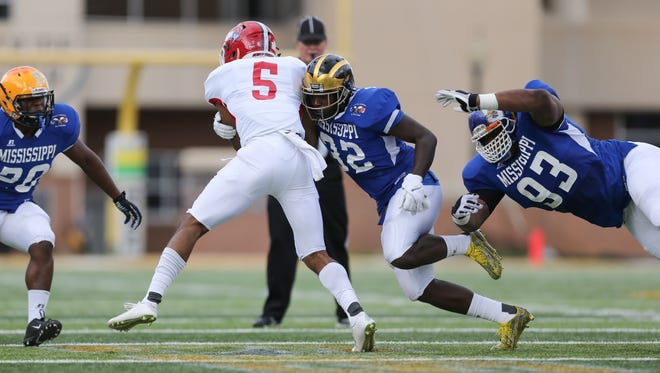 Mississippi's Racheem Boothe (32) tackles Alabama's Jarrion Street (5) on Saturday during the Mississippi-Alabama All-Star Game in Hattiesburg. Mississippi won the game 28-21.