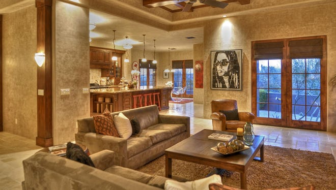Former child star Frankie Muniz wants to sell his Scottsdale home in the posh Estancia golf enclave for $2.795 million. Here is the family room.