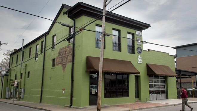 The exterior of Cochon Butcher, I Love Juice Bar and Little Donkey in Historic Germantown.