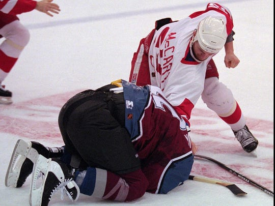 "The ""Brawl in Hockeytown"" on March 26, 1997 at Joe Louis Arena is the signature moment of the bloody Red Wings-Avalanche rivalry that lasted for about a decade. Here, Darren McCarty punishes Claude Lemieux."