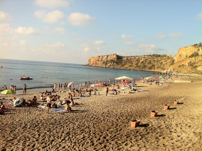 Beach-goers at the Torre Conca beach near Finale, Sicily.