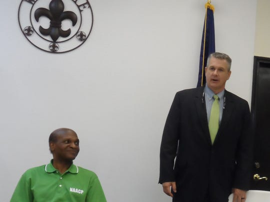 Jared Medaries (right), an FBI special agent, speaks at a Town Hall meeting hosted by the NAACP in Pineville on Thursday. At left is state NAACP President Ernest Johnson.